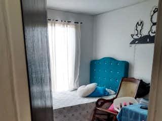 Una sala de estar con un sofá y una silla en Apartamento en Venta Porvenir, Rionegro