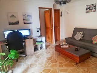 Una sala de estar llena de muebles y una televisión de pantalla plana en Apartaestudio en Venta LA PILARICA