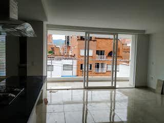 Una vista de una habitación con una puerta de cristal en Apartamento en venta en La Castellana, 95mt con balcon