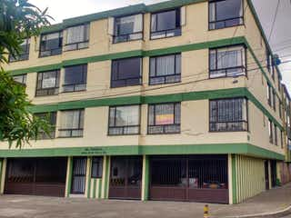 Un gran edificio con un gran edificio en él en VENDO APARTAMENTO VILLA LUZ