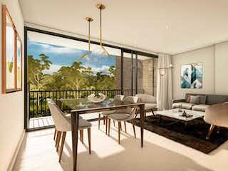 Una vista de una sala de estar y comedor en Recinto Gualanday Aptos