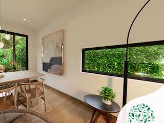 Una sala de estar llena de muebles y una gran ventana en Natura House