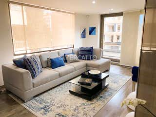 Una sala de estar llena de muebles y una ventana en Venta Apartamento San Patricio