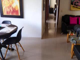 Una sala de estar llena de muebles y un gato en C.R. BARCELONA.