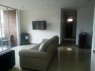 Una sala de estar llena de muebles y una televisión de pantalla plana en C.R. ST ETIENNE.