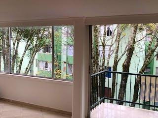 Un dormitorio con un gran ventanal y un gran ventanal en Apartamento en venta en Santa Mónica, 103mt con balcon