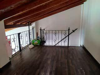 Una habitación con suelos de madera y suelos de madera en Apartamento en Venta LA MOTA