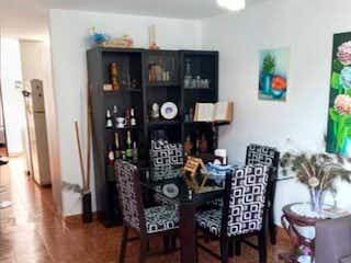 Una sala de estar llena de muebles y una televisión en Apartamento De Segundo Piso En Boyaca Las Brisas Medellin - Antioquia