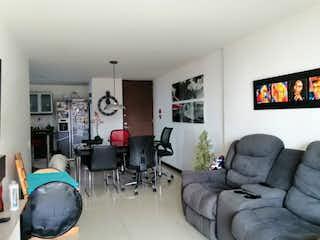 Una sala de estar llena de muebles y una televisión de pantalla plana en Apartamento en venta en San Diego, 90mt con balcon