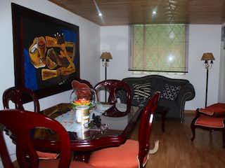 Un comedor con una mesa y sillas en Venta apartamento Villas de Granada, Bogotá