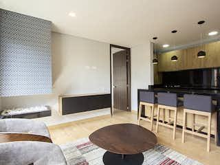 Una sala de estar llena de muebles y una televisión de pantalla plana en Apartamento en venta en Rosales, de 51mtrs2