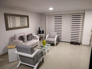 Una sala de estar llena de muebles y una televisión de pantalla plana en Apartamento en venta en Las Lomitas, 133mt con balcon