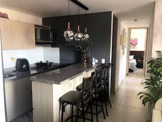 Una cocina con una mesa y sillas en ella en Apartamento en venta en Ditaires de 3 habitaciones