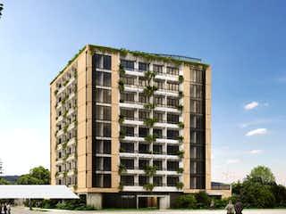Un edificio alto con un edificio grande en el fondo en Urban Chicó