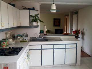 Una cocina con una estufa de fregadero y nevera en Apartamento en venta en Velódromo de 3 hab.