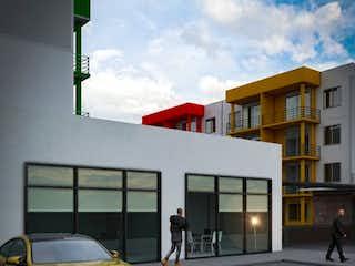 Una señal de calle con un edificio en el fondo en Apartamento en Venta SOPETRAN