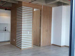 Una cocina con nevera y una estufa en Apartaestudio en Venta PRADOS DE SABANETA