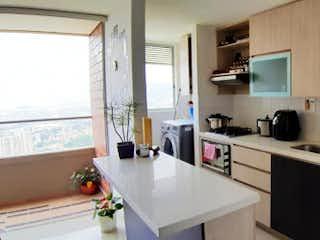 Una cocina con fregadero y nevera en Apartamento en Venta VEREDA LAS LOMITAS