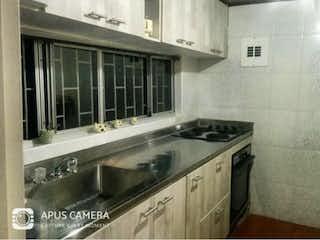 Una foto en blanco y negro de una cocina en Apartamento en venta en Santa María Del Lago 85m²