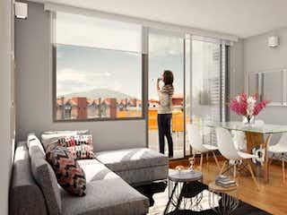 Una sala de estar llena de muebles y una ventana en Akora