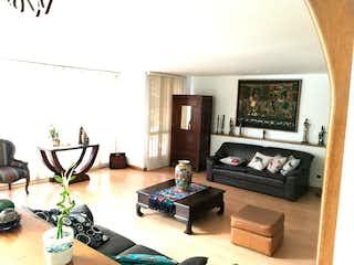Una sala de estar llena de muebles y una televisión de pantalla plana en 91970 - VENTA APARTAMENTO PATIO BONITO - POBLADO