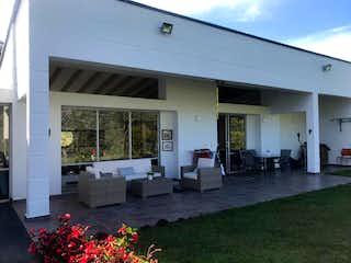Una vista de una casa con un jardín de flores en 2848 - Venta Casa Loma Escobero Envigado Medellin