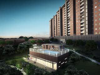 Un gran edificio con una torre de reloj en el centro en 96300 - Vendo moderno apartamento en San Antonio de Pereira Rionegro Antioquia