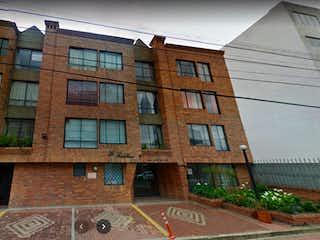 Un edificio con un reloj en el costado en Venta Apartamento La Castellana - 2958689