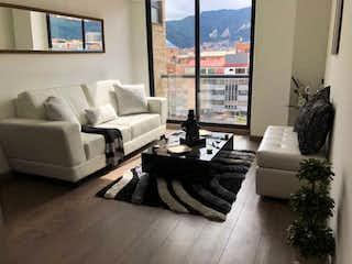 Una sala de estar llena de muebles y una gran ventana en Apartaestudio en venta en Santa Bárbara Central, 47mt con balcon