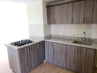 Una cocina con un fregadero y una estufa en Apartamento en Venta Sector Los Colegios, Rionegro