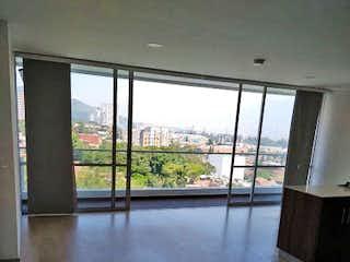 Una vista de una sala de estar con un gran ventanal en Apartamento en Venta LA ALDEA