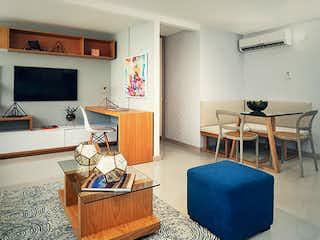 Una sala de estar llena de muebles y una televisión de pantalla plana en Apartamento en venta en San Martín El Ducado de 1 alcoba
