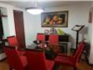 Una sala de estar llena de muebles y una chimenea en Apartamento En Venta En Bogota Colina Campestre