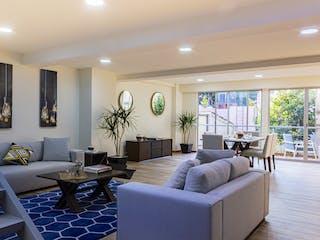 Una sala de estar llena de muebles y una gran ventana en ANX 821