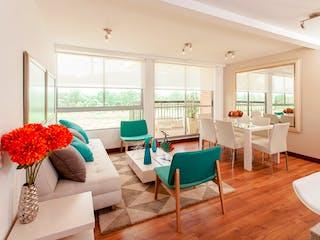 Una sala de estar llena de muebles y una gran ventana en Sendero de Girasoles