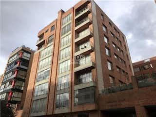 Un edificio alto sentado al lado de un edificio alto en Venta de apartamento en La Carolina (Bogotá)
