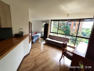 Una sala de estar llena de muebles y una televisión de pantalla plana en Apartaestudio en Venta en Avenida las Vegas