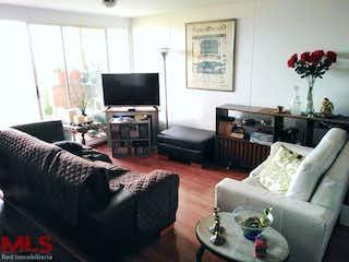 Una sala de estar llena de muebles y una televisión de pantalla plana en Lomas Del Viento
