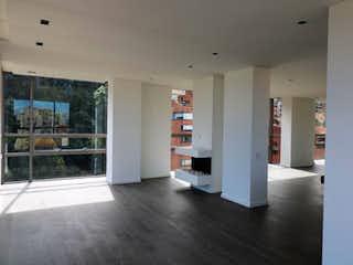 Una vista de una sala de estar y comedor en Edificio