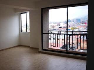 Una habitación que tiene una ventana y una vista del océano en Conjunto