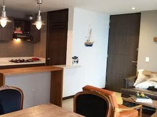 Una cocina con una estufa de fregadero y horno en Apartamento en Venta ALTOS DEL POBLADO