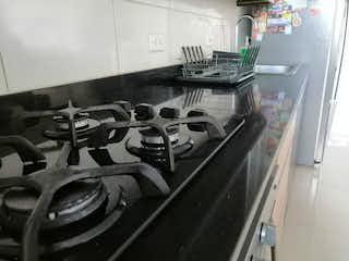 Una cocina llena de un montón de pares de tijeras en Apartamento en Venta LAS PALMAS