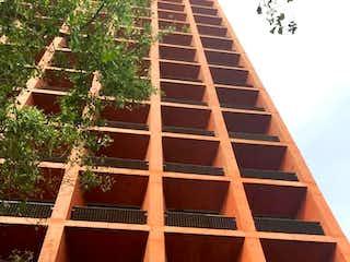 Un edificio alto con un pájaro sentado encima en Departamento Tabacalera, Av. Paseo de la Reforma, RDV481914, RDR498781