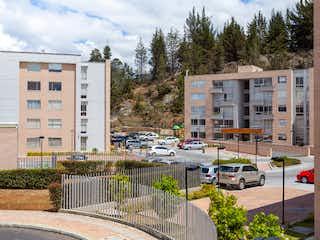 Una calle de la ciudad llena de mucho tráfico en 91961 - Apartamento en Venta Tocancipa Monteverde Parque Residencial