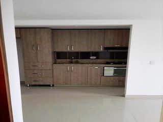 Una cocina con armarios de madera y un suelo de madera en Apartamento en Venta RIONEGRO