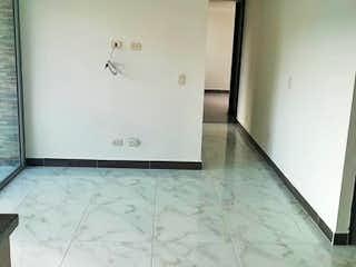 Un refrigerador congelador blanco sentado dentro de una cocina en Apartamento en Venta SAN GERMAN