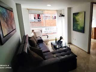Una sala de estar llena de muebles y una chimenea en Apartamento en Venta SABANETA