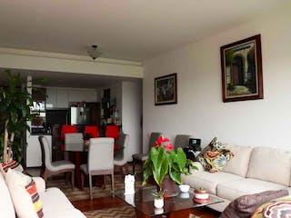 Una sala de estar llena de muebles y una televisión de pantalla plana en Departamento Venta en Desierto de los Leones, Tetelpan