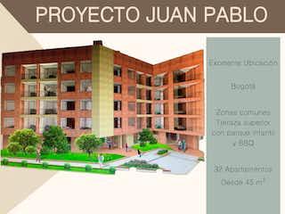 Una imagen de un edificio con una señal de calle en Juan Pablo