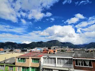 Una vista de un pueblo en la distancia en Apartamento En Venta En Bogota Santa Isabel-Martires